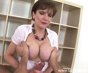 Mature lady pleasing a hard dick with her hands and oiled up jugs