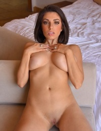 Stacked brunette stunner spreads her pussy lips with her slim fingers