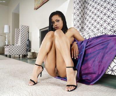 Hot black girl Kira Noir slips off lingerie before ramming a dildo up her ass