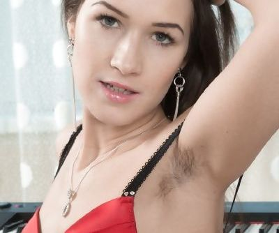 Female keyboard player Helga delights in displaying hairy armpits and pussy