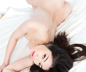 Nude Japanese females fondle each other while readying for a lesbian kiss