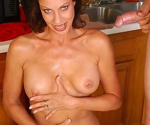 Older broad Vanesa riding younger mans dick on chair in kitchen