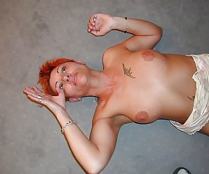 Short-haired mature redhead gets her pussy licked and cocked up