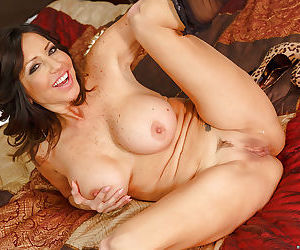 Fake tit Latina MILF Tara Holiday enjoying a big meaty cock up her cunt