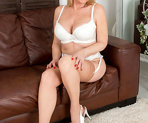 Mature mom with sexy legs in stockings undressing to bare big tits & hot pussy