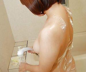 Bosomy asian sweetie Tomoko Ochiai caresses herself taking shower