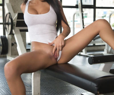 Latina model Denisse Gomez undressing in gym for fingering of horny pussy