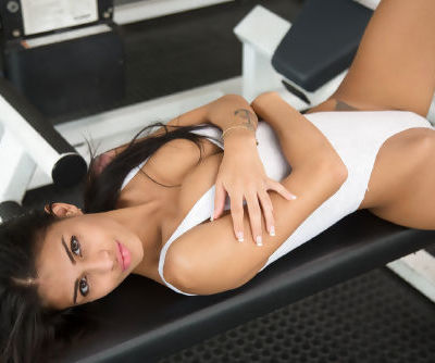 Latina model Denisse Gomez undressing in gym for fingering of horny pussy