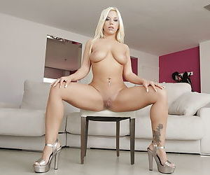 Blonde mom Blondie Fesser showing off nice round booty on couch