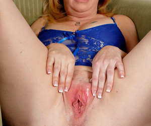 Older plumper Brandie Sweet hikes her lingerie to play with her pink pussy