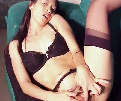Steamy asian girl with slim curves stripping down to her panties