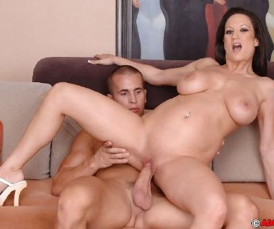Full-bosomed brunette MILF with shaved cunt gives head and gets fucked tough