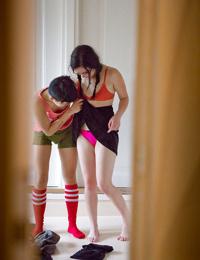 Young dyke girls Twyla and Marietta M dress nerdy bodies after having sex