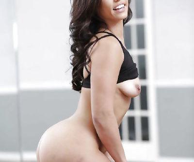 Dark haired babe Kelsi Monroe sliding spandex pants over phat ass