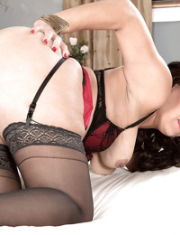 Mature brunette Latina Gabriella Sky flaunting butt in stockings and heels