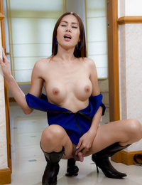 Hot young ladyboy Bow strikes sexy solo pose in policeman uniform