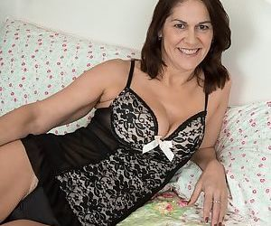 Mature mom Kaysy spreads her hairy pussy hidden behind black panties