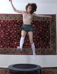 Innocent young slut Susie Randolph bouncing naked on a trampoline