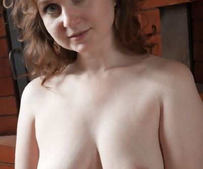 Cute mature Bazhena undressing to show off her saggy tits and bare butt