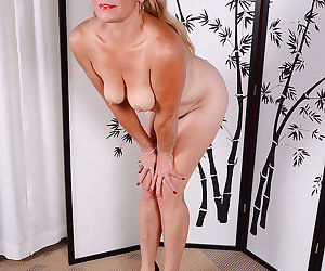 Experienced blonde lady Cristine Ruby exposing hairy upskirt vagina