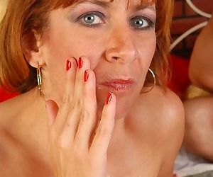 Mature redhead MILF Mikela having puffy over 40 pussy licked out
