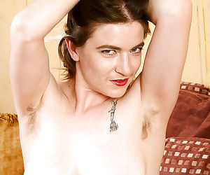 Bikini clad model Tink showing off hairy underarms and beaver