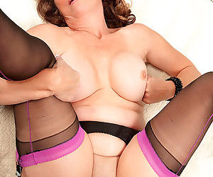 Middle-aged lady Lydia South seduces her young lover in stockings and garters