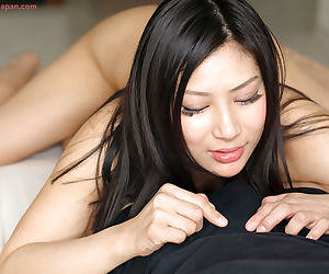 Japanese female licks sperm off of her fingers after a POV handjob