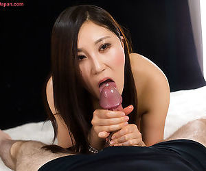 Sexy Asian grips the cock hard to give a messy handjob with cum explosion