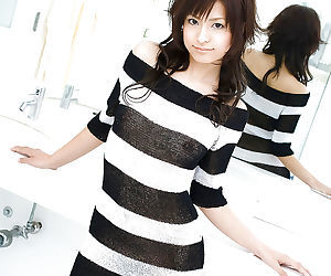 Alluring asian coed on high heels Misaki Mori stripping off her dress