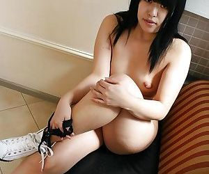 Chubby asian gal Yoshino Ohata strips down and gets her shaved cunt fingered