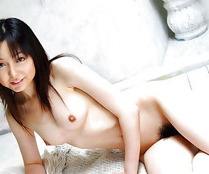 Foxy asian babe Yui Hasumi stripping off her lingerie on the bed