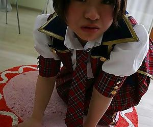 Asian schoolgirl Mayu Nakane revealing her nice ass and inviting gash