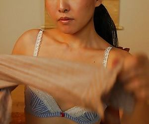Asian lassie Yukie Ishikawa gets naked and has some pussy fingering fun