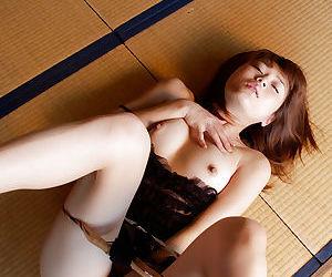Kyoko Nakajima showcasing her tits with hard nipples and hairy cooter