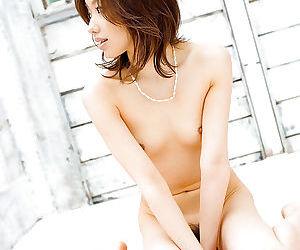 Seductive asian babe Jun Kiyomi taking off her dress and panties