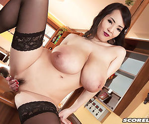 Japanese solo model wraps her huge boobs around bar pole in black nylons