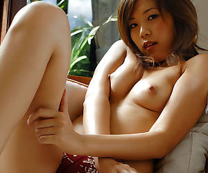 Sexy asian babe on high heels Asami Ogawa taking off her lingerie top