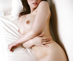 Busty asian babe with sexy ass Takako Kitahara stripping off her clothes