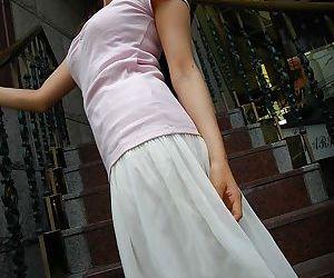 Alluring asian babe Rikako Yokoyama getting rid of her clothes