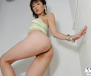 Sexy asian babe uncovering her titties and spreading her legs