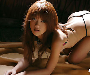 Foxy asian babe with tiny tits Mai Kitamura slipping off her lingerie top