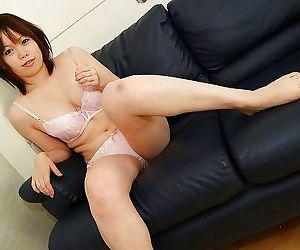 Sweet asian babe Yukari Fukada undressing and posing on the bed