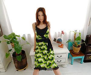 Graceful asian hottie Anari Suzuki slipping off her dress and lingerie