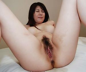 Horny asian MILF with hairy vag Izumi Hori gets cocked up and creampied