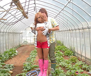 Hot redhead Raina Ogami getting her Japanese pussy banged in the greenhouse