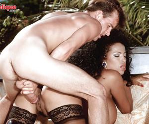 Older Latina pornstar Busty Angelique revealing huge knockers in stockings