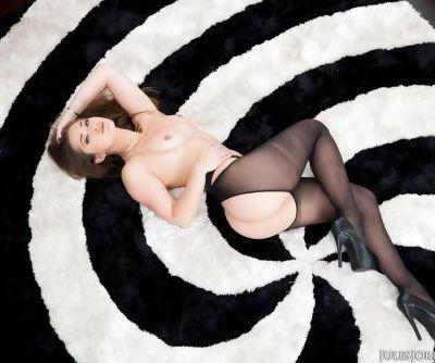 Solo model Dani Daniels poses in assless pantyhose on condo balcony