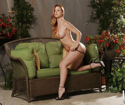 Big-tit babe Karlie Montana is playing with pussy on the sofa