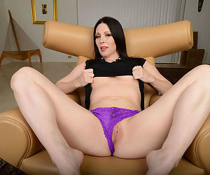 Dark haired mom RayVeness slips off her panties to show her trimmed muff